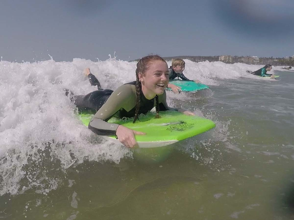 Tullamore Central School student Paris Curr catches a break from the drought with surfing lessons in Sydney during a visit to Epping Boys High School.